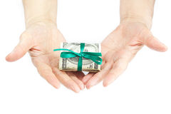 Dollars rolled into a tube in the hands Royalty Free Stock Images