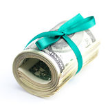 Dollars rolled into a tube tied with ribbon Royalty Free Stock Photos