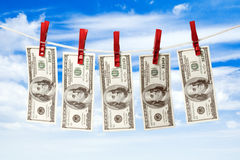 Dollars on rope. Dollars on a rope isolated on blue sky background Royalty Free Stock Photography