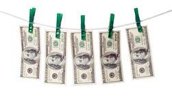 Dollars on rope. Stock Photo