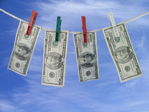 Dollars on the rope. Money-laundering Stock Image