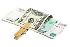 Dollars and rubles with clothespin Stock Photos