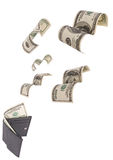 Dollars run away from wallet isolated Stock Photos