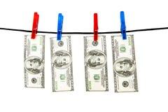 Dollars s'arrêtant sur une corde Photographie stock