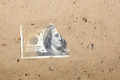 Dollars in the sand Royalty Free Stock Photography