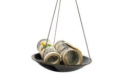 Dollars on the scales Stock Images