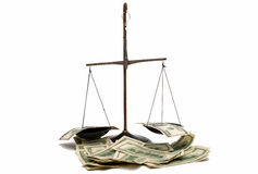 Dollars on the scales Royalty Free Stock Photo