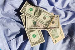 Dollars on a shirt Stock Photos