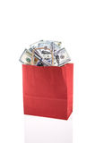 Dollars in shopping bag Stock Photos