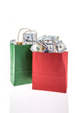 Dollars in shopping bags Royalty Free Stock Photography