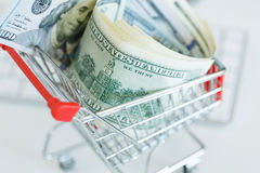 Dollars in the shopping cart on a computer keyboard Royalty Free Stock Photography