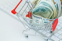 Dollars in the shopping cart on a computer keyboard Royalty Free Stock Photo