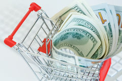 Dollars in the shopping cart - concept of online shopping Stock Image