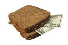 Dollars between slices of bread Royalty Free Stock Images