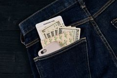 Dollars, smart and plane ticket in your pocket jeans. Royalty Free Stock Photos