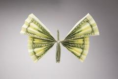 Dollars sous forme de papillons images libres de droits