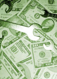 Dollars with spanners Royalty Free Stock Photography