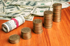 Dollars and stairs of coins Royalty Free Stock Photos