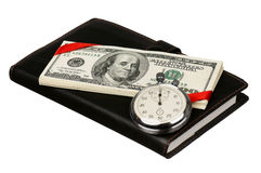 Dollars and stopwatch Stock Photo