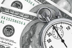 Dollars and Stopwatch Royalty Free Stock Images
