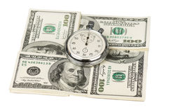Dollars and stopwatch Royalty Free Stock Photos