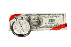 Dollars and stopwatch Stock Photos