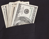 Dollars in suit pocket Stock Photography