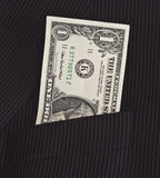 Dollars in suit pocket. One dollar bill in suit pocket stock photo