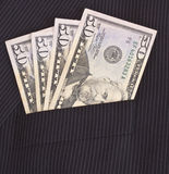 Dollars in suit pocket. Fifty dollar bills in a suit pocket stock photo