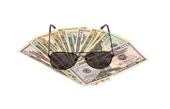 Dollars and sunglasses. On a white background isolated Royalty Free Stock Images