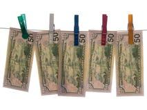 Dollars sur la corde à linge Image stock