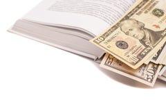 Dollars sur le livre ouvert Photo stock