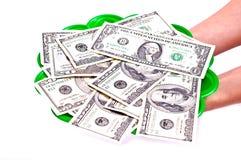 Dollars sur un plateau Photographie stock libre de droits
