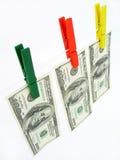 Dollars sur une corde à linge images libres de droits