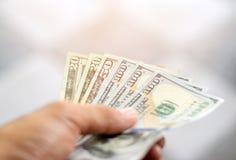 Dollars ter beschikking Stock Foto's