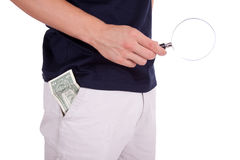 Dollars Theme. Holding a hand lens  and a dollar in your pocket Stock Photo