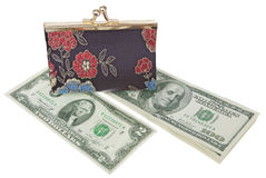 Dollars Theme. Purse on top of a dollars,  top view Royalty Free Stock Photos