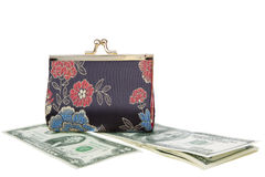 Dollars Theme. Purse on top of a dollars, in a horizontal position Royalty Free Stock Photos