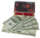 Dollars Theme. Purse on top of a dollars, top view ,open wallet stock photos