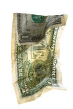 Dollars Theme. Crumpled one dollar in an upright position royalty free stock photography