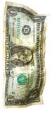 Dollars Theme. Crumpled one dollar in an upright position Stock Images