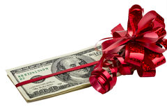 Dollars tied with a red bow Royalty Free Stock Image