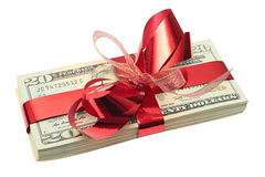 Dollars. Tied up by a red ribbon with bow-knot Stock Images