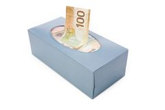 Dollars in a tissue box Stock Photography