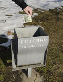 Dollars to the litter bin. Russians throw dollars to the litter bin showing that they do not need American money stock image