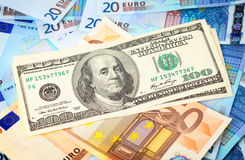 Dollars on top of Euro Stock Image