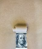 Dollars through torn green paper Stock Images