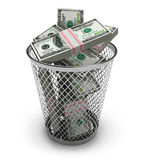 Dollars in the trash bin. Isolated on white background Royalty Free Stock Photography
