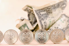 Dollars under coin protection. Crumbpled dollars under coin protection Royalty Free Stock Image