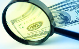 Dollars under a magnifying glass Royalty Free Stock Photography